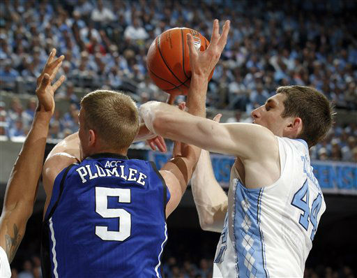 North Carolina forward Tyler Zeller &#40;44&#41; struggles for possession against Duke forward Mason Plumlee &#40;5&#41; during the first half of an NCAA college basketball game in Chapel Hill, N.C., Wednesday, Feb. 8, 2012.  <span class=meta>(AP Photo&#47; Jim R. Bounds)</span>
