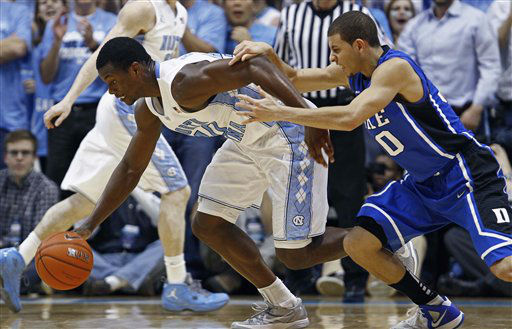 North Carolina&#39;s Harrison Barnes, left, and Duke&#39;s Seth Curry chase the ball during the first half of an NCAA college basketball game in Chapel Hill, N.C., Wednesday, Feb. 8, 2012.  <span class=meta>(AP Photo&#47; Gerry Broome)</span>