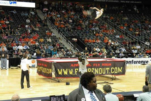 "<div class=""meta ""><span class=""caption-text "">The halftime entertainment featured two extreme trampoline jumpers (WTVD/Britt Guarglia)</span></div>"