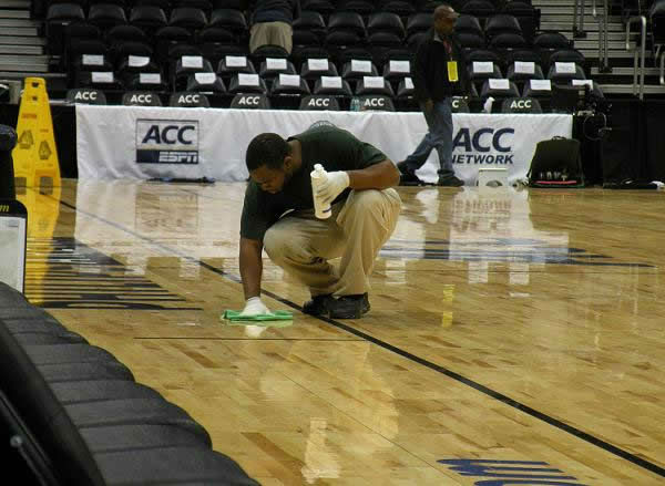 An arena employee cleans the floor by hand before the next team takes the court <span class=meta>(WTVD&#47;Britt Guarglia)</span>