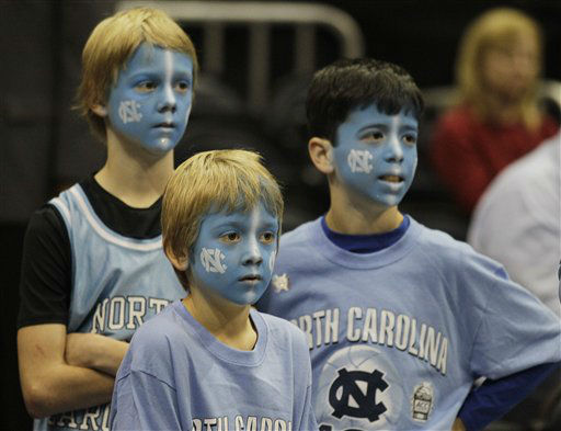 North Carolina fans watch play during the first half of an NCAA college basketball game against Maryland in the quarterfinals of the Atlantic Coast Conference tournament, Friday, March 9, 2012, in Atlanta.  <span class=meta>(AP Photo&#47; Chuck Burton)</span>