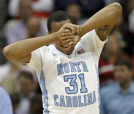 North Carolina forward John Henson &#40;31&#41; comes off the court after being injured during the first half of an NCAA college basketball game against Maryland in the quarterfinals of the Atlantic Coast Conference tournament, Friday, March 9, 2012, in Atlanta.  <span class=meta>(AP Photo&#47; John Bazemore)</span>