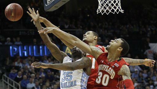 North Carolina guard Reggie Bullock &#40;35&#41; Maryland guard Mychal Parker, center, and Maryland forward Ashton Pankey &#40;30&#41; reach for a rebound during the first half of an NCAA college basketball game in the quarterfinals of the Atlantic Coast Conference tournament, Friday, March 9, 2012, in Atlanta.  <span class=meta>(AP Photo&#47; Chuck Burton)</span>