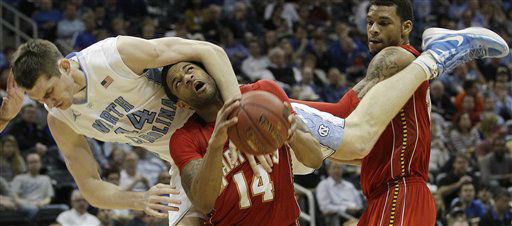 North Carolina forward Tyler Zeller &#40;44&#41; drags down Maryland guard Sean Mosley &#40;14&#41; as Maryland forward Ashton Pankey &#40;30&#41; looks on during the first half of an NCAA college basketball game in the quarterfinals of the Atlantic Coast Conference tournament, Friday, March 9, 2012, in Atlanta. Zeller was called for a foul.  <span class=meta>(AP Photo&#47; Chuck Burton)</span>