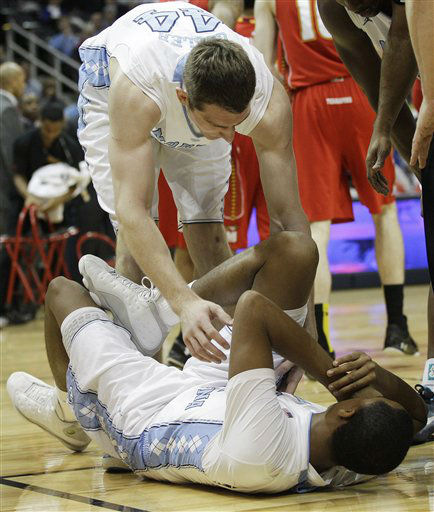 North Carolina forward Tyler Zeller &#40;44&#41; attends to his teammate,  North Carolina forward John Henson &#40;31&#41; after Henson was injured during the first half of an NCAA college basketball game against Maryland in the quarterfinals of the Atlantic Coast Conference tournament, Friday, March 9, 2012, in Atlanta. <span class=meta>(AP Photo&#47; Chuck Burton)</span>