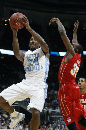 North Carolina guard Justin Watts &#40;24&#41; shoots against Maryland forward James Padgett &#40;35&#41; during the first half of an NCAA college basketball game in the quarterfinals of the Atlantic Coast Conference men&#39;s tournament, Friday, March 9, 2012, in Atlanta.  <span class=meta>(AP Photo&#47; John Bazemore)</span>