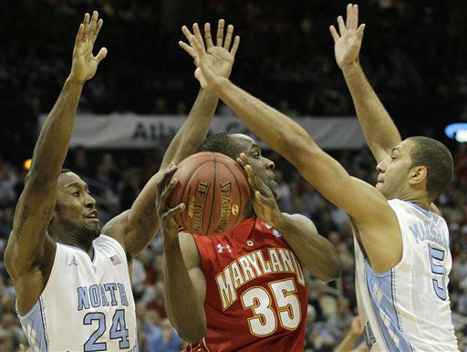 Maryland forward James Padgett &#40;35&#41; looks to pass under pressure from North Carolina guard Justin Watts &#40;24&#41; and North Carolina guard Kendall Marshall &#40;5&#41; during the second half of an NCAA college basketball game in the quarterfinals of the Atlantic Coast Conference tournament, Friday, March 9, 2012, in Atlanta.  <span class=meta>(AP Photo&#47; Chuck Burton)</span>