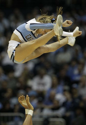 "<div class=""meta ""><span class=""caption-text "">North Carolina cheerleaders perform during the first half of an NCAA college basketball game against Maryland in the quarterfinals of the Atlantic Coast Conference tournament, Friday, March 9, 2012, in Atlanta.  (AP Photo/ Chuck Burton)</span></div>"