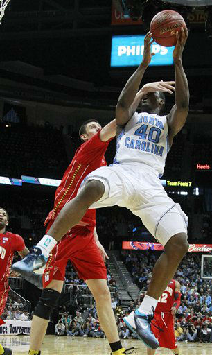 North Carolina forward Harrison Barnes &#40;40&#41; shoots under pressure from Maryland center Alex Len &#40;25&#41; during the second half of an NCAA college basketball game in the quarterfinals of the Atlantic Coast Conference tournament, Friday, March 9, 2012, in Atlanta. North Carolina won 85-69.  <span class=meta>(AP Photo&#47; John Bazemore)</span>