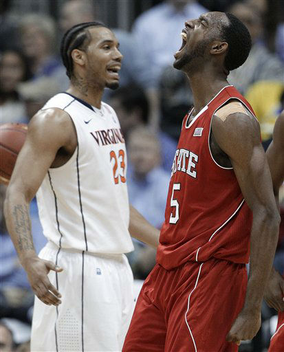 North Carolina State forward C.J. Leslie &#40;5&#41; reacts after scoring a basket as Virginia forward Mike Scott &#40;23&#41; stands nearby during the first half of an NCAA college basketball game in the quarterfinals of the Atlantic Coast Conference men&#39;s tournament, Friday, March 9, 2012, in Atlanta.  <span class=meta>(AP Photo&#47; Chuck Burton)</span>