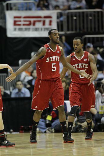 "<div class=""meta image-caption""><div class=""origin-logo origin-image ""><span></span></div><span class=""caption-text"">North Carolina State forward C.J. Leslie (5) reacts after scoring a basket during the first half of an NCAA college basketball game against Virginia in the quarterfinals of the Atlantic Coast Conference tournament,  Friday, March 9, 2012, in Atlanta.  (AP Photo/ Chuck Burton)</span></div>"