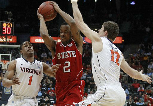 "<div class=""meta image-caption""><div class=""origin-logo origin-image ""><span></span></div><span class=""caption-text"">North Carolina State guard Lorenzo Brown (2) moves through Virginia guard Jontel Evans (1) and Virginia guard Joe Harris (12) during the first half of an NCAA college basketball game in the quarterfinals of the Atlantic Coast Conference mens tournament, Friday, March 9, 2012, in Atlanta.  (AP Photo/ John Bazemore)</span></div>"