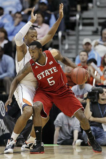 North Carolina State forward C.J. Leslie &#40;5&#41; works around Virginia guard Rob Vozenilek &#40;11&#41; during the first half of an NCAA college basketball game in the quarterfinals of the Atlantic Coast Conference men&#39;s tournament Friday, March 9, 2012, in Atlanta.  <span class=meta>(AP Photo&#47; Chuck Burton)</span>