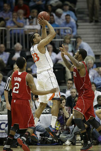 Virginia forward Mike Scott &#40;23&#41; shoots against North Carolina State during the second half of an NCAA college basketball game in the quarterfinals of the Atlantic Coast Conference tournament,  Friday, March 9, 2012, in Atlanta.  <span class=meta>(AP Photo&#47; Chuck Burton)</span>