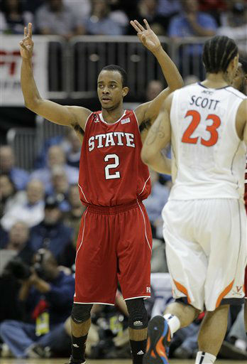 North Carolina State guard Lorenzo Brown &#40;2&#41; calls a play as Virginia forward Mike Scott &#40;23&#41; walks by during the second half of an NCAA college basketball game in the quarterfinals of the Atlantic Coast Conference tournament,  Friday, March 9, 2012, in Atlanta.  <span class=meta>(AP Photo&#47; Chuck Burton)</span>