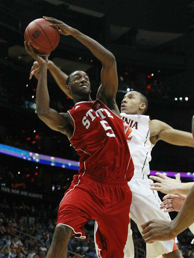 North Carolina State forward C.J. Leslie &#40;5&#41; shoots as Virginia forward Darion Atkins &#40;32&#41; defends during the first half of an NCAA college basketball game in the quarterfinals of the Atlantic Coast Conference tournament,  Friday, March 9, 2012, in Atlanta. <span class=meta>(AP Photo&#47; John Bazemore)</span>