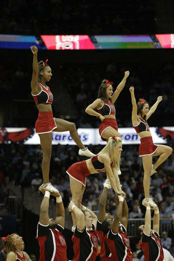 "<div class=""meta image-caption""><div class=""origin-logo origin-image ""><span></span></div><span class=""caption-text"">North Carolina State cheerleaders perform during the first half of an NCAA college basketball game against the Virginia in the quarterfinals of the Atlantic Coast Conference tournament,  Friday, March 9, 2012, in Atlanta.  (AP Photo/ Chuck Burton)</span></div>"