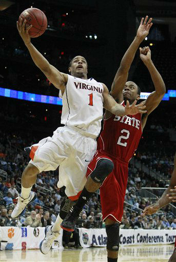 Virginia guard Jontel Evans &#40;1&#41; heads to the hoop as North Carolina State guard Lorenzo Brown &#40;2&#41; defends during the second half of an NCAA college basketball game in the quarterfinals of the Atlantic Coast Conference tournament,  Friday, March 9, 2012, in Atlanta. <span class=meta>(AP Photo&#47; John Bazemore)</span>
