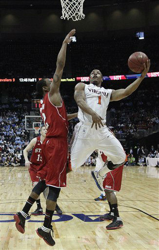 Virginia guard Jontel Evans &#40;1&#41; heads to the basket as North Carolina State guard Lorenzo Brown &#40;2&#41; defends during the first half of an NCAA college basketball game in the quarterfinals of the Atlantic Coast Conference tournament,  Friday, March 9, 2012, in Atlanta.  <span class=meta>(AP Photo&#47; Chuck Burton)</span>