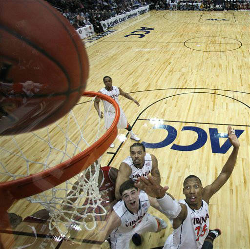 "<div class=""meta ""><span class=""caption-text "">Virginia forward Akil Mitchell (25) shoots as Virginia guard Joe Harris (12) and Virginia forward Mike Scott (23) look on during the first half of an NCAA college basketball game against North Carolina State in the quarterfinals of the Atlantic Coast Conference tournament,  Friday, March 9, 2012, in Atlanta.  (AP Photo/ Chuck Burton)</span></div>"
