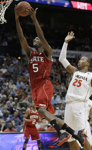 North Carolina State forward C.J. Leslie &#40;5&#41; heads to the basket as Virginia forward Akil Mitchell &#40;25&#41; defends during the second half of an NCAA college basketball game in the quarterfinals of the Atlantic Coast Conference men&#39;s tournament Friday, March 9, 2012, in Atlanta.  <span class=meta>(AP Photo&#47; Chuck Burton)</span>