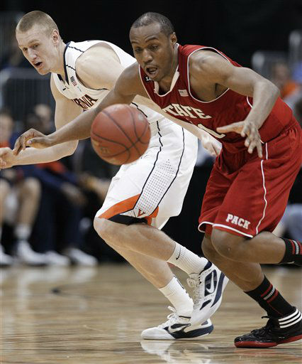 North Carolina State&#39;s C.J. Williams, right, vies for a loose ball as Virginia guard Paul Jesperson looks on during the second half of an NCAA college basketball game in the quarterfinals of the Atlantic Coast Conference men&#39;s tournament Friday, March 9, 2012, in Atlanta.  <span class=meta>(AP Photo&#47; Chuck Burton)</span>
