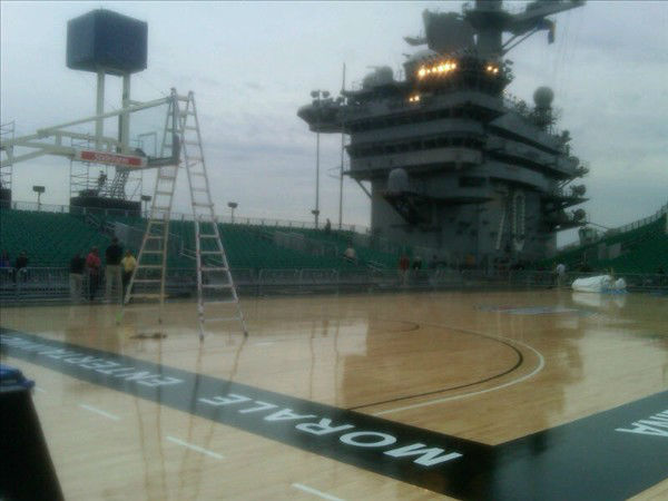 "<div class=""meta image-caption""><div class=""origin-logo origin-image ""><span></span></div><span class=""caption-text"">Preparations in San Diego on the USS Carl Vinson to convert its flight deck to a basketball arena for the first ever NCAA Carrier Classic basketball game featuring the UNC Tar Heels and Michigan State. (WTVD Photo/ Charlie Mickens)</span></div>"
