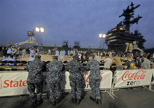 Navy personnel watch North Carolina players, left, practice along with Michigan State players for the Carrier Classic NCAA college basketball game aboard the USS Carl Vinson, Thursday, Nov. 10, 2011, in Coronado, Calif. North Carolina and Michigan State are scheduled to play the first Carrier Classic basketball game on the flight deck of the ship.  <span class=meta>(AP Photo&#47; Mark J. Terrill)</span>