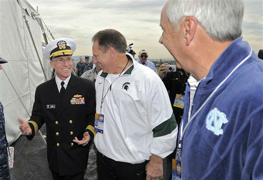 Rear Admiral Dennis Moynihan, left, talks with Michigan State head coach Tom Izzo, center, and North Carolina head coach Roy Williams before a news conference for the Carrier Classic NCAA college basketball game aboard the USS Carl Vinson, Thursday, Nov. 10, 2011, in Coronado, Calif. North Carolina and Michigan State will play the first Carrier Classic basketball game on the flight deck of the ship, Friday, Nov. 11.  <span class=meta>(AP Photo&#47; Mark J. Terrill)</span>