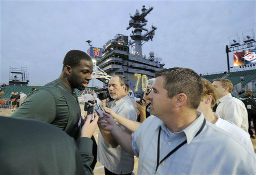 "<div class=""meta image-caption""><div class=""origin-logo origin-image ""><span></span></div><span class=""caption-text"">Michigan State's Draymond Green, left, talks with reporters during practice  for the Carrier Classic NCAA college basketball game aboard the USS Carl Vinson, Thursday, Nov. 10, 2011, in Coronado, Calif. North Carolina and Michigan State are scheduled to play play the first Carrier Classic basketball game on the flight deck of the ship.  (AP Photo/ Mark J. Terrill)</span></div>"