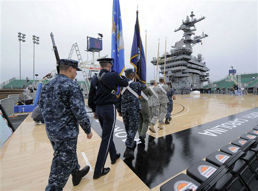 "<div class=""meta image-caption""><div class=""origin-logo origin-image ""><span></span></div><span class=""caption-text"">Military personnel practice the presentation of colors for the Carrier Classic NCAA college basketball game aboard the USS Carl Vinson, Thursday, Nov. 10, 2011, in Coronado, Calif. North Carolina and Michigan State  are scheduled to play the first Carrier Classic basketball game on the flight deck of the ship.  (AP Photo/ Mark J. Terrill)</span></div>"