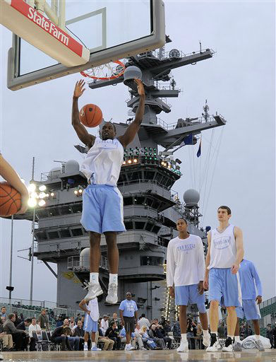 North Carolina&#39;s Harrison Barnes dunks during practice for the Carrier Classic college basketball game aboard the USS Carl Vinson, Thursday, Nov. 10, 2011, in Coronado, Calif. North Carolina and Michigan State are scheduled to play on Friday on the flight deck of the ship.  <span class=meta>(AP Photo&#47; Mark J. Terrill)</span>