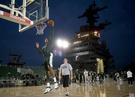 In a photo provided by the U.S. Navy, Michigan State&#39;s Adreian Payne dunks during basketball practice Thursday, Nov. 10, 2011, on the flight deck aboard the aircraft carrier USS Carl Vinson on Thursday, Nov. 10, 2011, in Coronado, Calif. Michigan State plays North Carolina in the Carrier Classic on Veterans Day, Friday. <span class=meta>(AP Photo&#47;U.S. Navy, Mass Communication Specialist 2nd Class James R. Evans)</span>