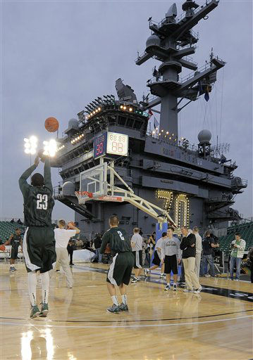 Michigan State&#39;s Draymond Green, left, shoots during practice for the Carrier Classic NCAA college basketball game aboard the USS Carl Vinson, Thursday, Nov. 10, 2011, in Coronado, Calif. North Carolina and Michigan State are scheduled to play on the flight deck of the ship on Friday. &#40; <span class=meta>(AP Photo&#47; Mark J. Terrill)</span>