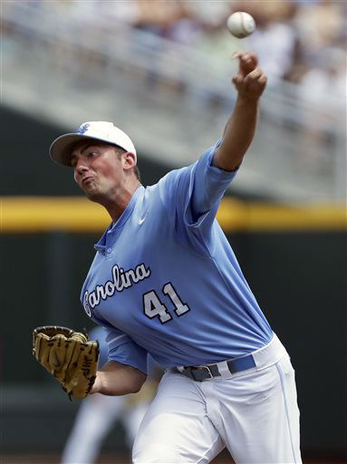 North Carolina starting pitcher Kent Emanuel delivers against North Carolina State in the first inning of an NCAA College World Series baseball game in Omaha, Neb., Sunday, June 16, 2013.  <span class=meta>(AP Photo&#47; Nati Harnik)</span>