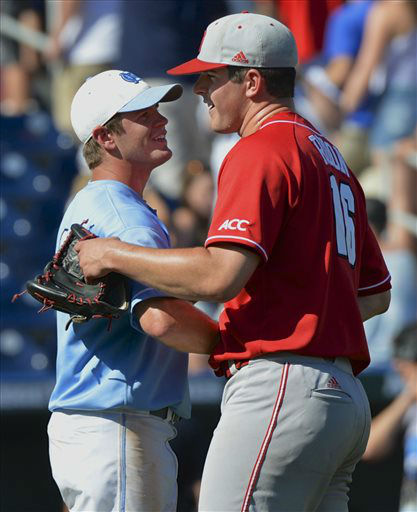 North Carolina State pitcher Carlos Rodon, right, is congratulated by North Carolina&#39;s Chaz Frank, following an NCAA College World Series game in Omaha, Neb., Sunday, June 16, 2013. Rodon pitched a complete game and Frank was the only North Carolina player to have scored against him in North Carolina State&#39;s 8-1 win.  <span class=meta>(AP Photo&#47; Ted Kirk)</span>