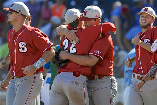 North Carolina State&#39;s Grant Clyde &#40;22&#41; hugs pitcher Carlos Rodon at the end of an NCAA College World Series game against North Carolina, in Omaha, Neb., Sunday, June 16, 2013. Rodon pitched a complete game in North Carolina State&#39;s 8-1 win.  <span class=meta>(AP Photo&#47; Eric Francis)</span>