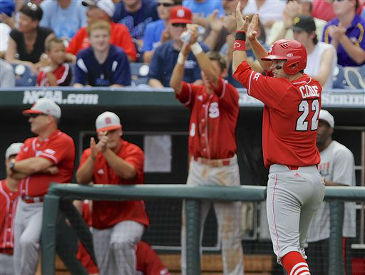 North Carolina State&#39;s Grant Clyde &#40;22&#41; applauds after scoring on a double by Brett Williams in the third inning against North Carolina in an NCAA College World Series baseball game in Omaha, Neb., Sunday, June 16, 2013.  <span class=meta>(AP Photo&#47; Eric Francis)</span>