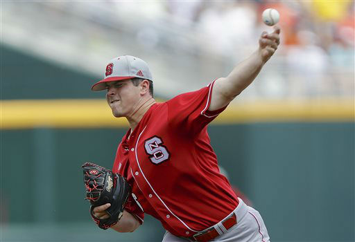North Carolina State starting pitcher Carlos Rodon throws against North Carolina in the first inning of an NCAA College World Series game in Omaha, Neb., Sunday, June 16, 2013.  <span class=meta>(AP Photo&#47; Nati Harnik)</span>