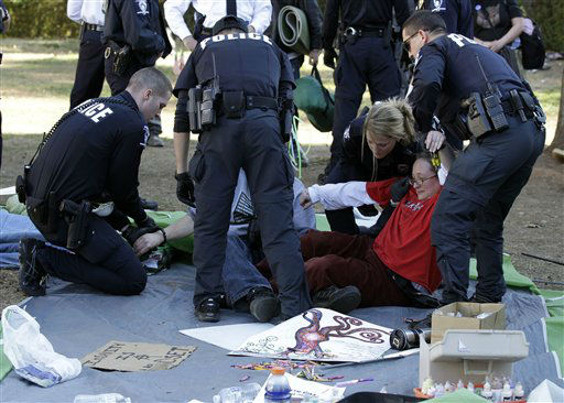 "<div class=""meta ""><span class=""caption-text "">Charlotte-Mecklenburg Police arrest members of the Occupy Charlotte movement as they remove tents belonging to the group from city-owned property in Charlotte, N.C., Monday, Jan. 30, 2012. (AP Photo/Chuck Burton)</span></div>"