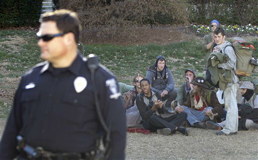 Members of the Occupy Charlotte movement look on after Charlotte-Mecklenburg police removed tents belonging to the group from city-owned property in Charlotte, N.C., Monday, Jan. 30, 2012. (AP Photo/Chuck Burton)