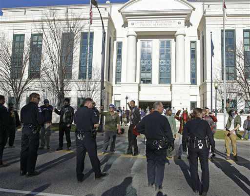 "<div class=""meta ""><span class=""caption-text "">Charlotte-Mecklenburg police move members of the Occupy Charlotte movement from the street in front of the police headquarters in Charlotte, N.C., Monday, Jan. 30, 2012. (AP Photo/Chuck Burton)</span></div>"