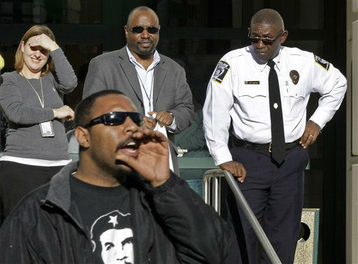 "<div class=""meta ""><span class=""caption-text "">Charlotte-Mecklebnburg police chief Rodney Monroe, back right, looks on as Yen Alcala, front, of the Occupy Charlotte movement shouts in front of the police department's headquarters in Charlotte, N.C., Monday, Jan. 30, 2012. (AP Photo/Chuck Burton)</span></div>"
