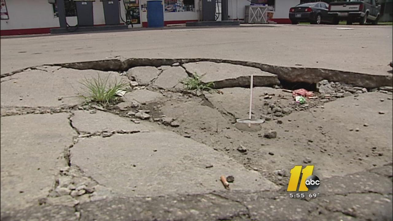 Large potholes are causing problems for not only Stem Mini Mart, but also its customers