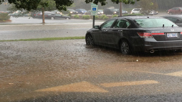 "<div class=""meta image-caption""><div class=""origin-logo origin-image ""><span></span></div><span class=""caption-text"">A slow moving summer storm system dumped heavy rain in parts of northern Wake County Wednesday. (WTVD Photo/ Charles Murray)</span></div>"
