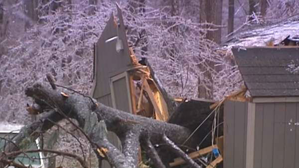 "<div class=""meta image-caption""><div class=""origin-logo origin-image ""><span></span></div><span class=""caption-text"">A blast of rain, sleet, and ice brought down trees and caused thousands of power outages across the region. Seeing damage where you are? Send your pictures to iwitness@abc11mail.com. (WTVD)</span></div>"