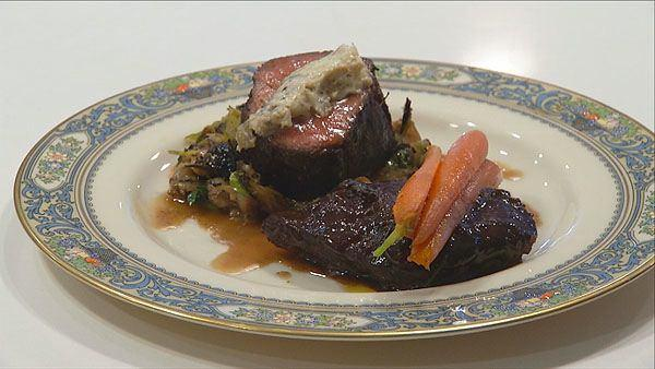Black Garlic Crusted Filet with Braised Short-Rib, Baby Carrots, Brussels Sprouts and Shallot-Maytag Blue Cheese Butter