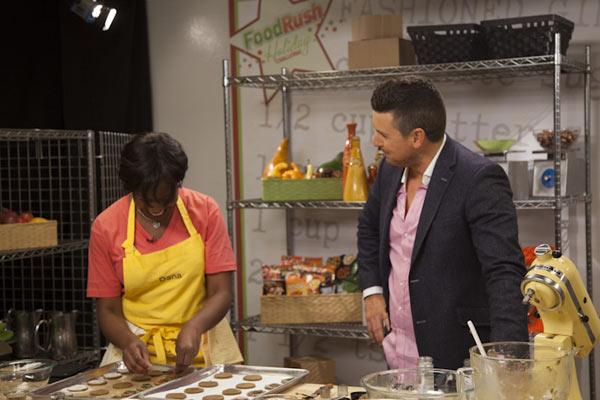 Chef Ryan Scott watches as contestant Dana...