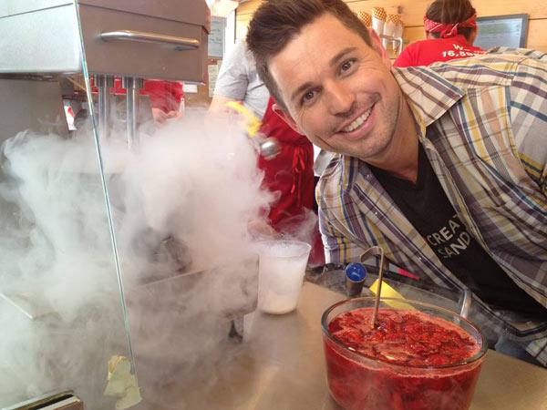 Ryan poses in front of Smitten Ice Cream's...
