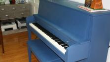 This piano has a beautiful sound, but the high-gloss black color doesnt match the rooms new look. Instead, it gets a new look with bright blue chalkboard paint.
